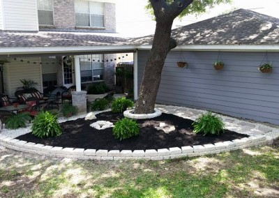 Landscaping In Back Yard For A San Antonio Home Owner